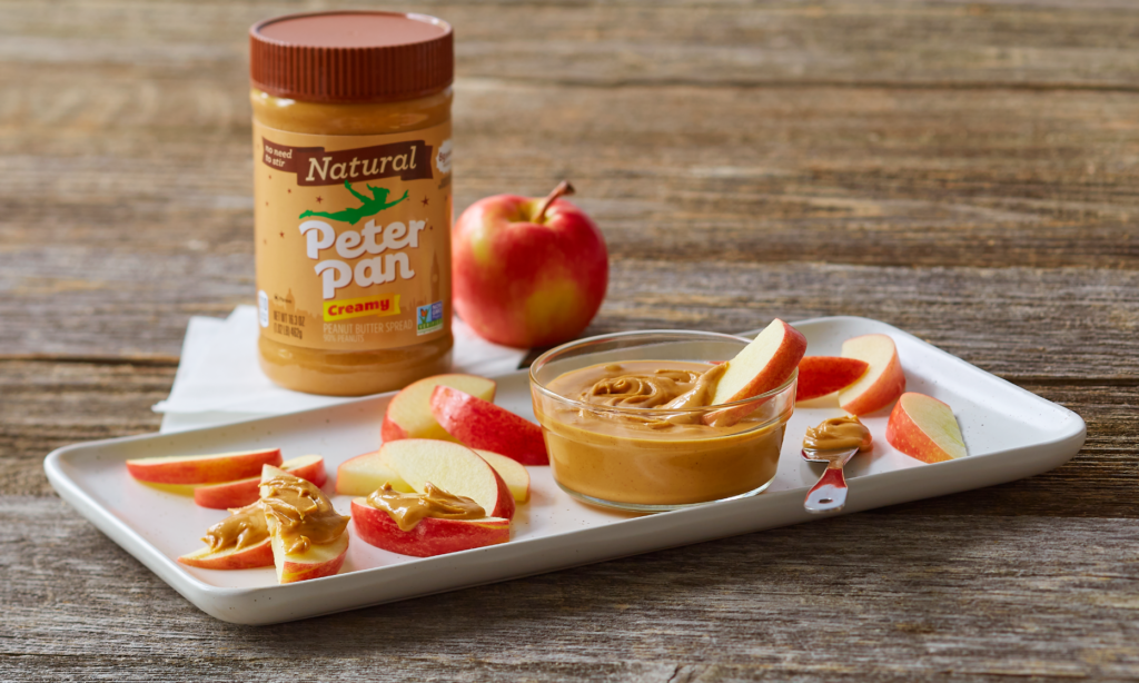 Peter Pan Natural Creamy Peanut Butter served with apple slices