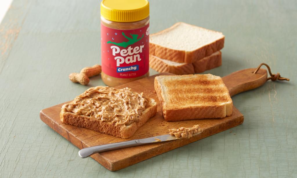 Peter Pan Regular Crunchy Peanut Butter served on toast